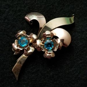 Vintage gold tone pin with turquoise crystals